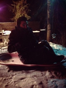 GetKnit Guru Justin Sledding on a Cold Minnesota Night